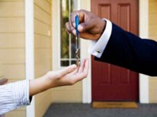 man handing keys to new homeowner