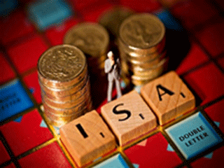 isa on scrabble board and coins