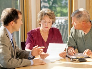 retired couple looking at finance documents