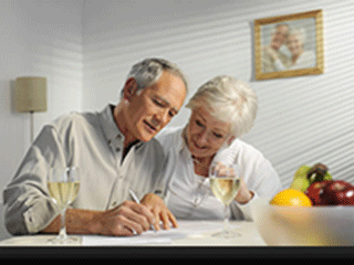 retired couple looking at documents