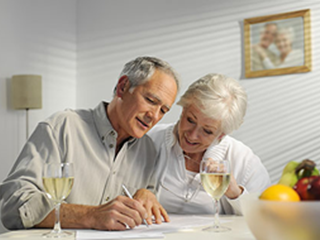 elderly couple looking at documents