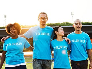 group of people in volunteer t-shirts