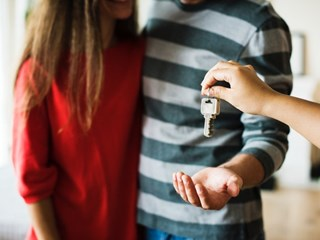 couple being given key to home