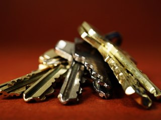 close up of metal keys on red background