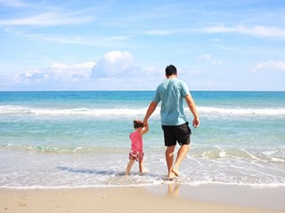 man and child at the beach