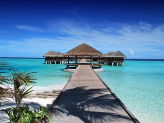 wooden walkway across clear ocean