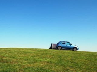 car on a grassy field