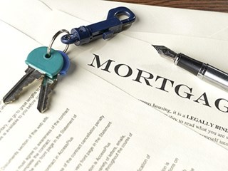 mortgage documents with keys