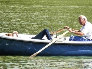 senior couple on rowing boat