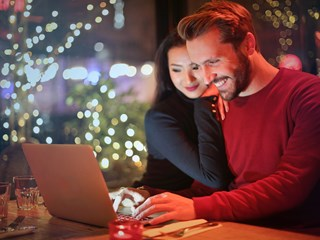 Christmas couple laptop loans